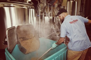 Paul Johnson with spent grain - Photo by James Dr. Fermento Roberts - HooDoo Brewing Co.